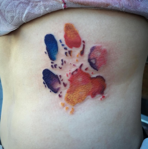 10-foxfacedkelley-watercolor-paw-print-rib-cage-tattoo