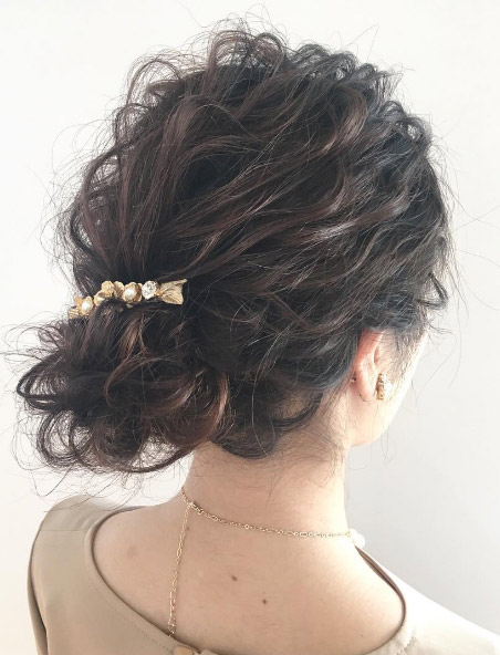 k_______ta-barrette-curly-hair